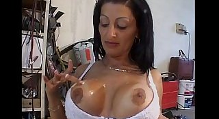 Sexy milf jerks off her pussy in a garage